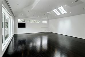 Large Studio with skylight, wall of windows, skylights, vaulted ceiling, art lighting, ceiling speakers and remote blinds make this multi purpose room a winner. Perfect for a music room, hobby room, master suite, yoga studio, ballet/dance studio or just divide for two additional bedrooms in the house!
