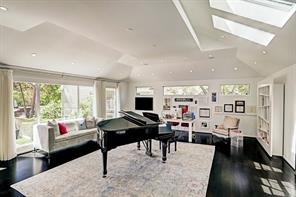 Banks of windows, skylights and clerestory windows help capture the grandeur of this expansive music room.  Versatile in use, it can be used as a game room or additional room for hosting gatherings of friends and family.