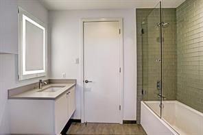 Full bath positioned off main upstairs hallway boasts immaculate subway tile surround and shower/tub combination.
