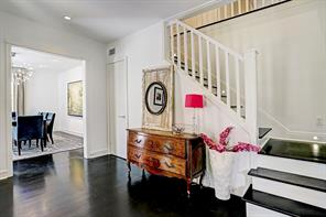 Anchored by gleaming hardwood floors and staircase with wood treads, the entry reflects the warmth and beauty of the home.
