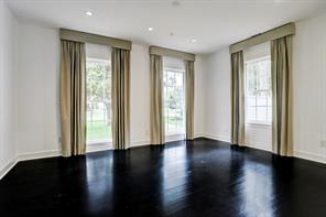 Formal dining room with gleaming hardwood floors with picturesque views of the front lawn.