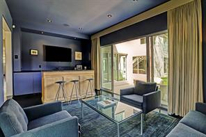 Sunken snug room is perfect for entertaining and gathering of friends.