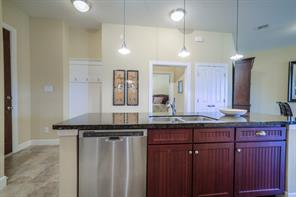 Very spacious open kitchen with granite island and stainless steel appliances.