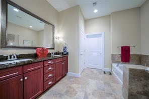 Large master bathroom with dual sinks and separate bathtub and shower.