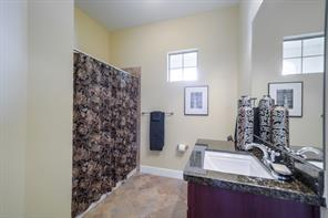 Very nice bathroom with tile floors and granite countertops.