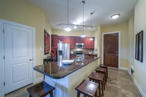 Another view of the spacious kitchen with island.