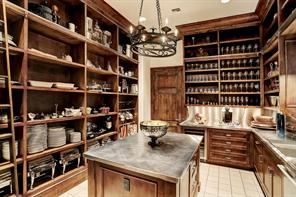 KITCHEN (20 X 19):Venetian plaster walls; barreled brick vaults with stained 'fir' beamed ceiling; Alder cabinetry with top of cabinet display space; under cabinet lighting; statuary white slab honed countertops & backsplash; white marble slab island with under-mount sink with faucet and vegetable sprayer; Bluestar 8 burner cooktop & double convection ovens; Artisan coffee maker; Subzero built-in stainless refrigerator / freezer; warming drawer; Miele dishwasher; walnut inlay flooring; 3 panel F