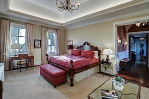 GUEST SUITE BEDROOM (23 X 15): Multi-piece crown molding and base boards; wool carpet inlaid in floor; tray ceiling with ambient lighting; custom iron 5 candle chandelier with glass globe; designer draperies; private terrace with Pennsylvania blue slate floor, limestone balustrade with ceiling fans and mosquito control.