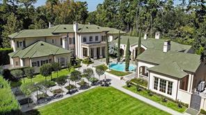 Aerial view of property showing the manicured grounds and private drive.