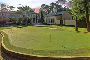 PUTTING GREEN: Endless hours of fun on your very own putting green! Manicured boxwood hedges weave throughout the grounds with landscaped lighting throughout the property.