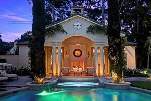 POOL HOUSE / HALF BATH: Offers Empress jade marble countertops, wainscoting