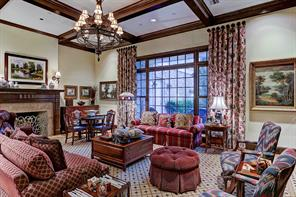 """[Den 25'6""""x18'8""""]Alternate view into the den/great room reveals the fireplace with tambour-carved mantel and marble surround."""