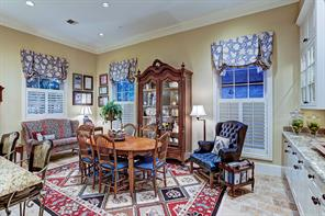 [Breakfast Room 18x11]Intimate and inviting, the breakfast room has a serving/storage cabinet with marble surface, lighted jumper cabinets, and plenty of room for seating in addition to a table.