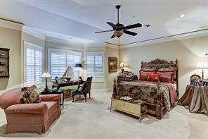 """[Master Bedroom 19'11""""x18'8""""]Secluded master bedroom offers a serene haven with bay windows overlooking the backyard and a soaring tray ceiling."""