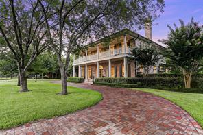 [Northeast Elevation]A sweeping brick-paver circular drive curves around to the front motor court.