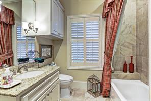 [Guest Room/Fourth Bedroom Bathroom]Guest Room/ Fourth Bedroom bathroom features a granite countertop, porcelain tile floor, and tub/shower with porcelain tile surround.