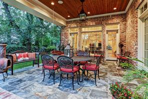 [Covered Patio]This inviting covered patio has slate hardscape and a tongue-in-groove ceiling.