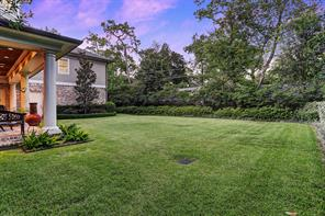 [Backyard]A sweeping lawn and mature gardens compose the backyard. Abundant space here for the addition of a pool (if desired) - with plenty of room left over for a play yard.