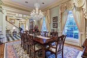 """[Formal Dining 17'10""""x14'4""""]Spacious dining room overlooks the front porch. Note paneled wainscot, hardwood floor, and nice internal vista into the foyer and living room."""