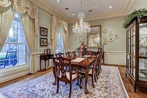 """[Formal Dining 17'10""""x14'4""""]A second view into the dining room from the foyer. Pivot door into the butler's pantry (not visible) is at right rear."""