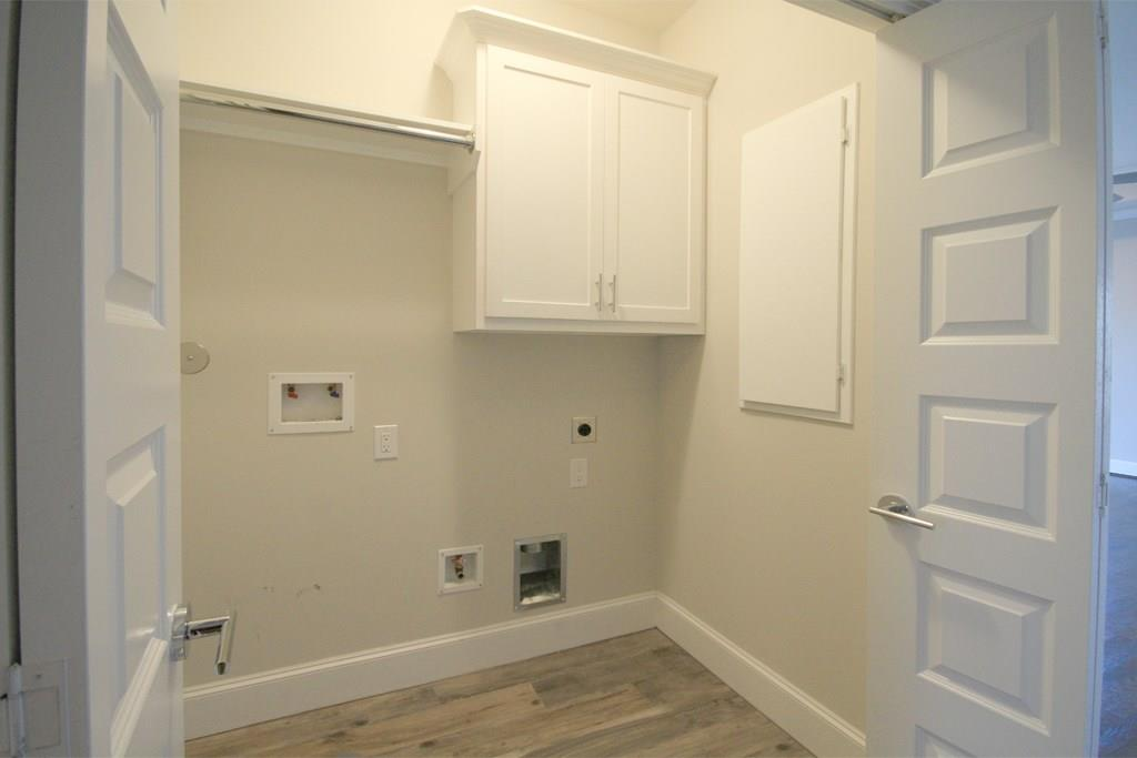 Third floor laundry room located between the master and second bedrooms
