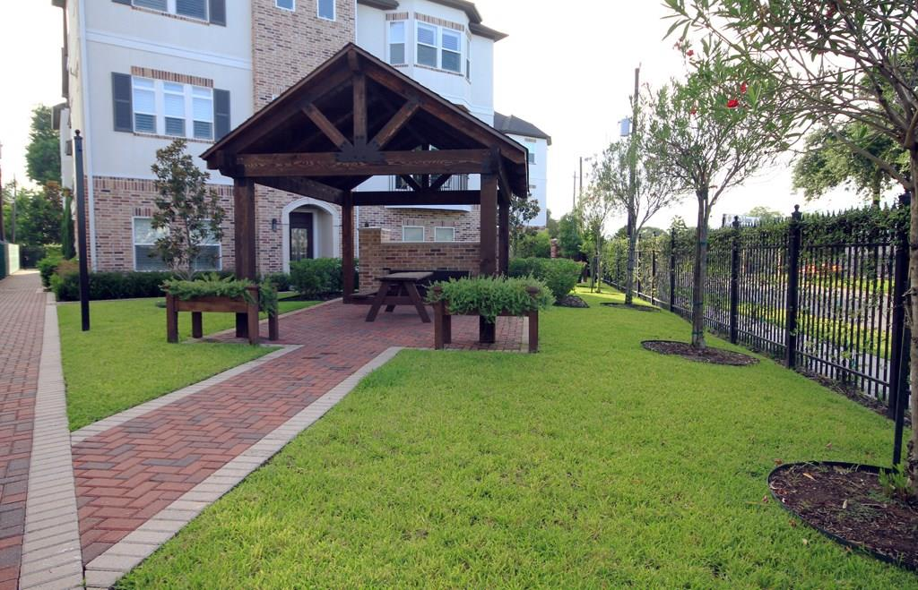 Beautiful green space and gazebo located directly behind the home