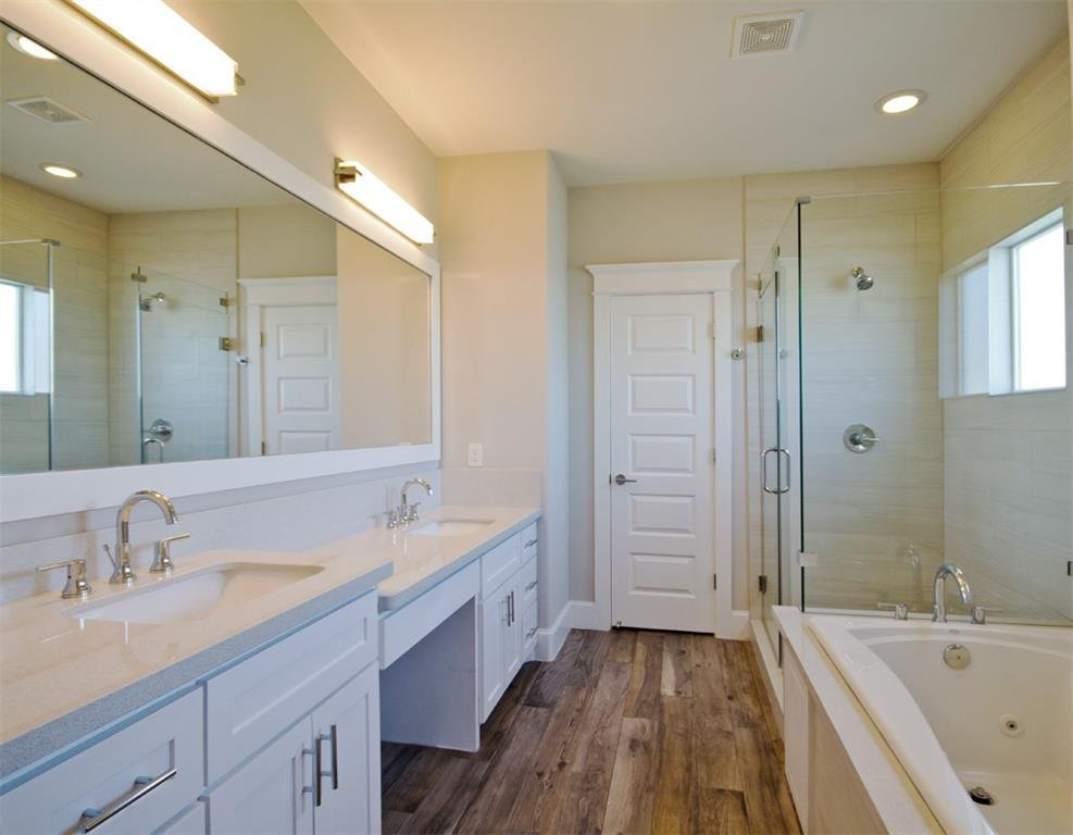 Dual sinks, quartz counters, separate frameless shower and jetted tub