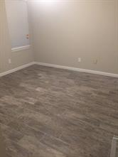 Bedroom is also updated with the wood tile floors and fresh paint. A neutral backdrop for any decor!