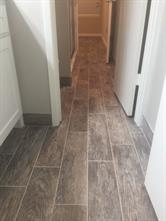 Wood tile continues throughout the entire condo, even as baseboards in the bathroom!