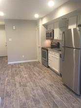 View of entire kitchen and dining area. This kitchen even has space for an island with seating!