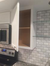 Brand new white cabinets with modern hardware.