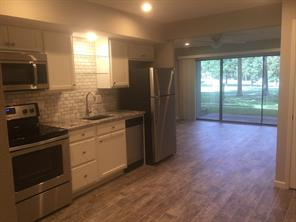 Kitchen, eat in dining area and living room overlook the golf course.