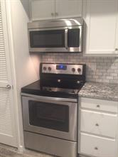 Stainless steel range and microwave.
