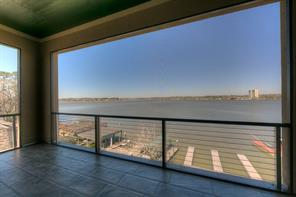 Breathtaking views of Lake Conroe from each level of this Modern home!