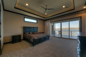 Plush carpet, recessed, lighted ceiling, custom drapes and a large door and windows that bring the lake in.