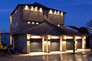 This Duplex is so pretty, especially at night with it's dramatic  custom lighting! Two car garage.