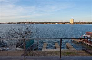 Breathtaking view of Lake Conroe from this private home! Boat slip offers convenient storage and one launches immediately into the lake! No coves and canals here!