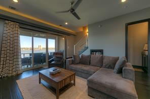 Lake Conroe awaits for your memories to begin! Look at the view from this Living area.