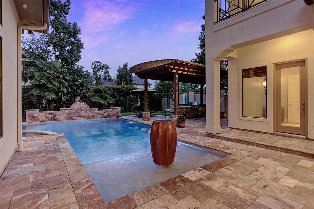 There is nothing cookie cutter about this spectacular Donald Schaney Custom Home ideally located in the highly acclaimed Estates section of Benders Landing! From the minute you walk into the courtyard you are in for a treat! Travertine surrounds the entire outdoor living space with it's own dining, living room with a fireplace, breathtaking pool & outdoor kitchen! Solid Oak Wood flooring, groin vault and coffered 12 foot ceilings,fixtures & even the cabinet knobs all scream custom. Stunning wall to wall windows bring the outdoors inside throughout the home.This aspiring chefs kitchen has granite,double ovens,warming drawer,Professional Kitchen Aid appliances 3 dishwashers and MUCH more! A whole house fire sprinkler system, whole house Generac 20k generator with a transit switch, A Rain bird 9 zone Sprinkler system, surround sound indoors and outdoors plus a whole home Kenmoor large capacity water softner are the icing on the cake!There is not enough room here to put all of the features