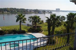 Over two acres, oversized pool, and a beautiful view of Lake Conroe.