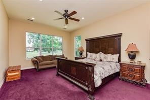 Terrific master suite - located on the other end of the home away from secondary bedrooms.  This is where the homeowner added strong color in the home, luckily - this is an easy change for anyone wanting something more neutral.  Views of the course never disappoint.