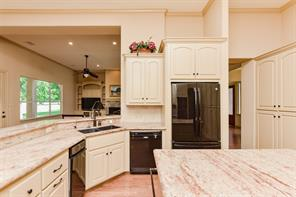 This angle shows the shortest route to the dining room (on the right).   What an easy flow to this gracious home.