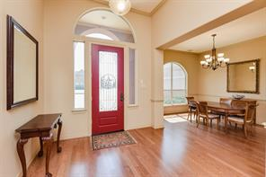 Light, bright & open - from the moment you step in.  And, look at those gorgeous hardwood floors.