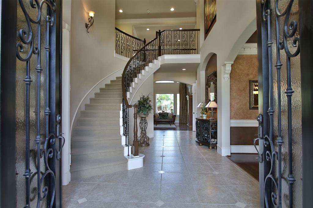 Just minutes from TX 99 and the Exxonmobil Campus! Custom Estate home in an exclusive Gated section of Windrose.  This expansive 4/5 bedrooms, 4.1 baths offers a second bedroom downstairs, private study, formal sitting room, plantation shutters throughout, open-concept living room with soaring ceilings. Kitchen includes oversized island, Jenn-Air appliances, granite counter tops and tons of storage. Master bedroom has beautiful tray ceilings and a lovely sitting area.  Large game room upstairs with gracious secondary bedrooms.  Lagoon style swimming pool with mosquito misting system.  3-car garage w/epoxy floors. Roof replaced in 2017. Zoned to highly acclaimed Klein ISD. If you don't buy this house, you'll wish you did!