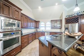 Oven and microwave, island electric and plenty of cabinetry for storage.