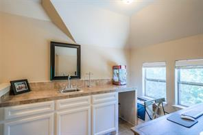 Also upstairs is a kitchenette area complete with sink and slot for refrigerator.