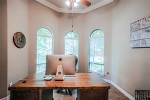 Study has bay-shaped window, tile and built-ins.