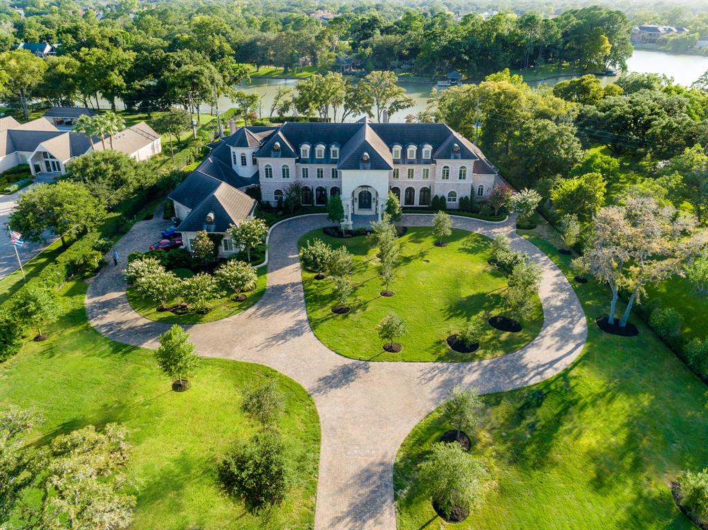 ELEGANT FRENCH ESTATE SITUATED ON A 2.6 ACRE WATERFRONT LOT IN THE HEART OF SUGAR LAND! BUILT BY RENOWNED BUILDER CHRISTOPHER SIMS THIS HOME IS THE EPITOME OF LUXURY! OLD WORLD ELEGANCE & AESTHETICS SEAMLESSLY BLEND W/MODERN TECHNOLOGY IN THIS ARCHITECTURAL MASTERPIECE. DRAMATIC FOYER W/SOARING CEILINGS, FLOATING CURVED STAIRCASE, STONE COLUMNS & IMPORTED STONE FLOORS. TWO STORY FORMAL LIVING W/HAND CARVED LIMESTONE FIREPLACE, FORMAL DINING W/WET BAR, GORGEOUS KITCHEN THAT CAME STRAIGHT OUT OF A MAGAZINE WITH STONE COUNTERTOPS, TWO INTEGRATED FRIDGES W/8 FREEZER DRAWERS & MUCH MORE, TWO STORY MASTER SUITE W/WOOD FLOORS & STONE FIREPLACE, LUXURIOUS SPA-LIKE MASTER BATH W/STEAM SHOWER, FURNITURE LIKE CUSTOM CABINETRY, STONE FLOORS, & TWO LARGE CLOSETS. HANDSOME STUDY W/CUSTOM WOODWORK. UPSTAIRS FEATURES 4 LARGE SUITES W/PRIVATE BATHS, ENTERTAINMENT WING FEATURES MULTIPLE GAMEROOMS, MEDIA ROOM, & WET BAR. BACKYARD OASIS W/POOL, LOGGIA W/OUTDOOR KITCHEN & PANORAMIC LAKE VIEWS! LOW TAXES!