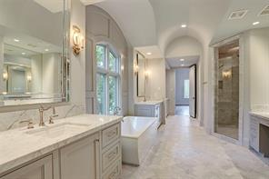 Relax and unwind in this exquisite master bathroom which features a free-standing soaking tub and gorgeous marble throughout. The builder has also installed additional sound insulation in the perimeter walls of the entire master suite for privacy.