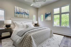 All secondary bedrooms include en suite bathrooms, hardwood floors and walk-in closets with custom-built chests and shelving.
